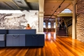 Wotif Group's Sydney Workplace - the reception desk is reminiscent of stacked luggage